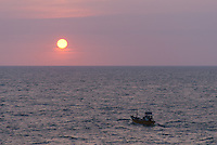 Fishing boat heads out to sea at sundown -Beruwala, Sri Lanka