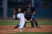 AZL Mariners catcher Brennon Kaleiwahea (13) prepares to apply the tag to Glenallen Hill Jr. (6) as home plate umpire Jesse Segura watches on during an Arizona League game against the AZL D-backs on July 3, 2019 at Salt River Fields at Talking Stick in Scottsdale, Arizona. The AZL D-backs defeated the AZL Mariners 3-1. (Zachary Lucy/Four Seam Images)