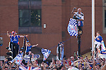 Rangers Fans in Manchester, 14/05/2008. Albert Square, UEFA Cup Final. Fans of Glasgow Rangers climbing on a lamppost in the centre of Manchester prior to watching the UEFA Cup final against Zenit St. Petersburg on a large screen in Albert Square, the location of one of the UEFA Fan Zones. The match was staged at the City of Manchester Stadium and was won by the Russian team by two goals to nil. It was Rangers' first European final appearance since they won the Cup-Winners Cup in 1972 and around 150,000 fans gathered in Manchester. Photo by Colin McPherson.