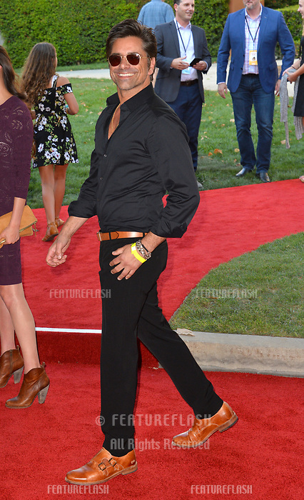 John Stamos at the world premiere of Disney's &quot;Christopher Robin&quot; at Walt Disney Studios, Burbank, USA 30 July 2018<br /> Picture: Paul Smith/Featureflash/SilverHub 0208 004 5359 sales@silverhubmedia.com