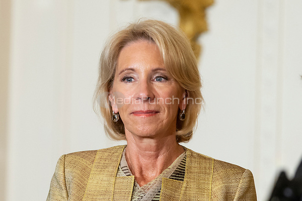 Education Secretary Betsy DeVos looks on during the National Teacher of The Year ceremony in the East Room of the White House in Washington, DC n May 2, 2018. Credit: Alex Edelman / CNP /MediaPunch