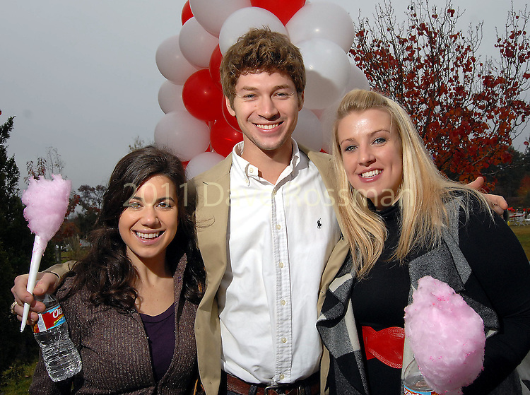 From left: Elise Maraist, Trey Jones and Lauren Klahn at the Lanier Law Firm's Holiday Bash Sunday Dec. 13,2009.(Dave Rossman/For the Chronicle)