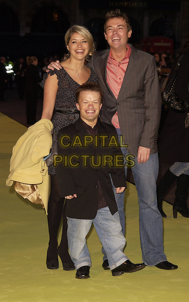 "HOLLY WILLOUGHBY, STEPHEN MULLHERN & GUEST.Arrivals at the World Premiere of ""Alien Autopsy"", .Odeon Leicester Square, London, .England, April 3rd 2006..full length ministry of mayhem mom presenters small person.Ref: CAN.www.capitalpictures.com.sales@capitalpictures.com.©Can Nguyen/Capital Pictures"