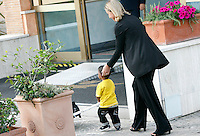 Martin, figlio della giovane sudanese Meriam Yahia Ibrahim Isha, insieme al Ministro degli Esteri Federica Mogherini, al suo arrivo da Khartoum all'aeroporto militare di Ciampino, Roma, 24 luglio 2014. Meriam, condannata a morte all'ottavo mese di gravidanza in Sudan, per apostasia e poi liberata, e' arrivata in Italia con i figli ed il marito, con un volo della presidenza del Consiglio, accompagnata dal Viceministro.<br /> Martin, son of Sudan's Meriam Yahia Ibrahim Isha, with Italian Foreign Minister Federica Mogherini after landing from Khartoum at Ciampino's military airport, on the outskirts of Rome, 24 July 2014. The Sudanese christian woman who was sentenced to death in Sudan for apostasy, has arrived in Italy with her children and her husband by an Italian government's aircraft, accompanied by deputy Minister.<br /> UPDATE IMAGES PRESS/Riccardo De Luca