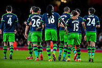 Swansea players walk away after celebrating Wayne Routledge of Swansea City 's goal during the Barclays Premier League match between Arsenal and Swansea City at the Emirates Stadium, London, UK, Wednesday 02 March 2016