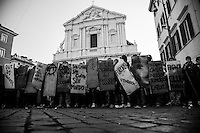 &quot;book blocs&quot; in front of Sant'Andrea della Valle church show their shields in form of classic books.<br /> Student groups (book blocs) and labor unions (Cobas) protested against the new government just formed and headed by the new prime minister Mario Monti. Rome, Italy.  17 november 2011