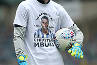 Millwall players wear t-shirts 'in memory of Christian Mbulu' as they warm up ahead of Millwall vs Swansea City, Sky Bet EFL Championship Football at The Den on 30th June 2020