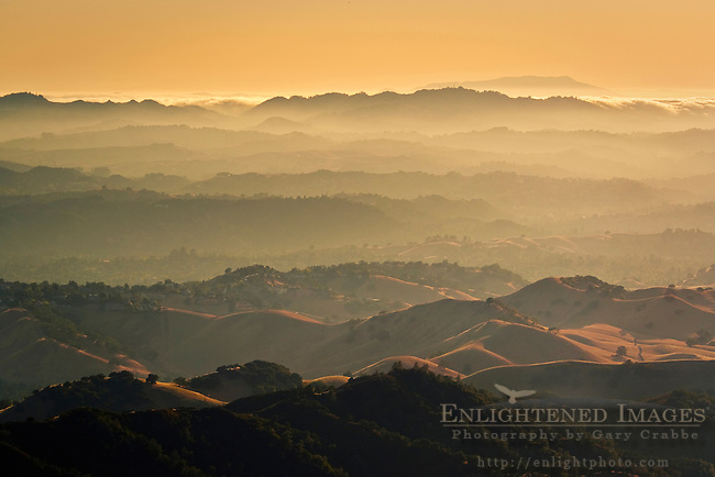 Sunset over the rolling hills of the east bay, looking toward Mount Tamalpais, from Mount Diablo State Park, California