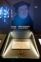 "La mostra sui segreti del Vaticano ""Lux in arcana"", apre nei Musei Capitolini. Un evento storico senza precedenti con 100 documenti originali provenienti dall'archivio Segreto Vaticano..L'editto di Worms di Carlo V contro Martin Lutero..""Lux in Arcana – The Vatican Secret Archives Reveals Itself"" exhibition, opens in the splendid halls of Rome's Capitoline Museums. An unprecedent cultural and media event: 100 original documents, preserved for 400 years in the papal archives, have crossed the boundaries of Vatican City for the first time ever, in order to be put on display at the Capitoline Museums in Rome..Charles V's Edict of Worms against Martin Lutero."
