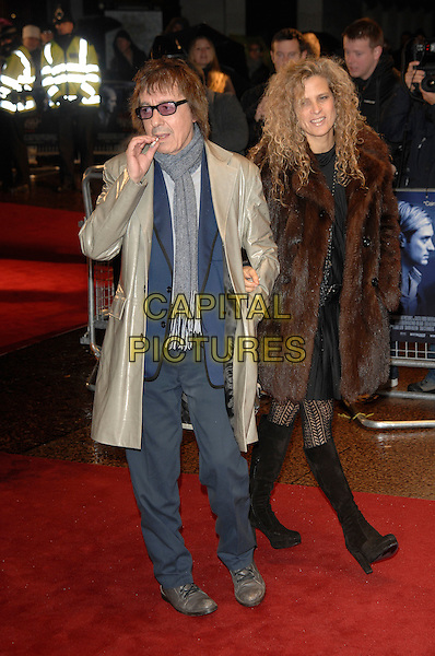 "BILL WYMAN, SUZANNE ACCOSTA.arriving by (No Smoking) taxi with a lit cigarette.""Sleuth"" European film premiere.Odeon West End cinema, Leicester Square, London, England.18th November 2007.full length scarf smoking cigarette wife brown fur coat jacket blue grey mac glasses.CAP/PL.©Phil Loftus/Capital Pictures"