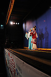 Ghost Month, Kaohsiung - Member(s) of the Rom Shing Hakka Opera Troupe acting in an open-air stage performance during Ghost Month in front of the Bao-Jhong Yi-Min Temple in Kaohsiung, Taiwan.
