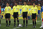 21 JUN 2010: Match officals. From left: Assistant referee Jeong Hae Sang (KOR), fourth official Subkhiddin Mohd Salleh (MAS), match referee Yuichi Nishimura (JPN), assistant refereee Toru Sagara (JPN). The Spain National Team defeated the Honduras National Team 2-0 at Ellis Park Stadium in Johannesburg, South Africa in a 2010 FIFA World Cup Group H match.