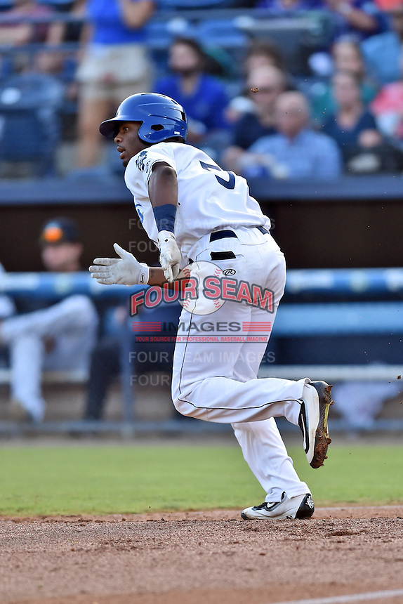 Asheville Tourists left fielder Terry McClure (5) runs to first base during a game against the Augusta GreenJackets at McCormick Field on August 5, 2016 in Asheville, North Carolina. The Tourists defeated the GreenJackets 7-6. (Tony Farlow/Four Seam Images)