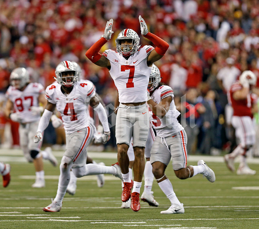 Ohio State Buckeyes safety Damon Webb (7) celebrates after an interception to end the game against Wisconsin Badgers in the Big Ten Championship game at the Lucas Oil Stadium in Indianapolis, Ind on December 2, 2017.  [Kyle Robertson/Dispatch]