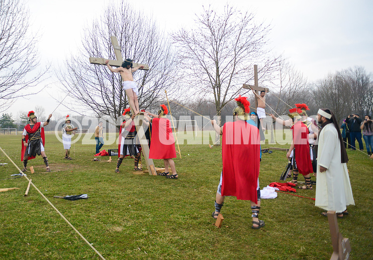 Roberto Marquez, of Bensalem, Pennsylvania portrays Jesus during the Stations of the Cross as he is crucified on Good Friday April 3, 2015 at Our Lady of Fatima in Bensalem, Pennsylvania.  (Photo by William Thomas Cain/Cain Images)