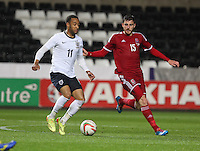 Pictured L-R: Nathan Redmond of England marked by Danny Alfei of Wales. Monday 19 May 2014<br />