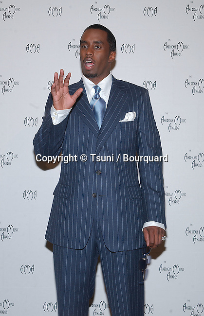 """Sean """"P.Diddy"""" Combos in the pressroom at the 29th Annual American Music Awards at the Shrine Auditorium in Los Angeles Wednesday, Jan. 9, 2002. He was co-host of the show.           -            Sean""""PDiddy""""Combs11.jpg"""