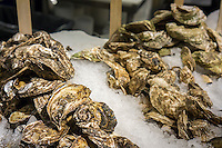 Oysters in Chelsea Market in New York at The Lobster Place on Friday, May 17, 2013. The market is a favorite destination for tourists and locals alike abounding in a myriad collection of restaurants and other food related businesses. The market is a destination for food tours as well as individuals looking to sample.  (© Richard B. Levine)