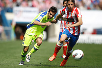 01.04.2012 MADRID, SPAIN -  La Liga match played between At. Madrid vs Getafe (3-0) at Vicente Calderon stadium. the picture show Pablo Sarabia Garcia (Midfielder of Getafe) and  Filipe Luis Karsmirski (Brazilian defender of At. Madrid)