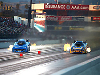 Nov 11, 2017; Pomona, CA, USA; NHRA funny car driver Tommy Johnson Jr (left) races alongside Ron Capps during qualifying for the Auto Club Finals at Auto Club Raceway at Pomona. Mandatory Credit: Mark J. Rebilas-USA TODAY Sports