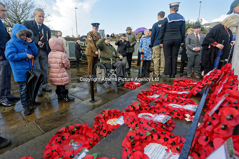 Pictured: A war veteran salutes after laying a wreath. Sunday 11 November 2018<br /> Re: Commemoration for the 100 years since the end of the First World War on Remembrance Day at the Swansea Cenotaph in south Wales, UK.