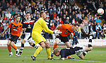 Jon Daly poised to head in to score for Dundee Utd as Dundee keeper Rab Douglas challenges for the ball