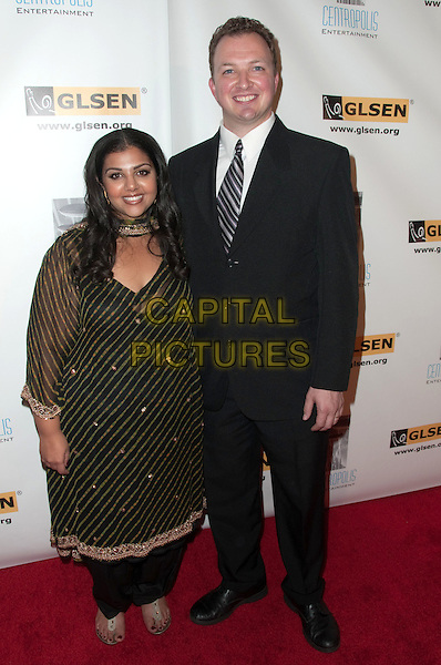FERIAL PEARSON & DAN PEARSON.6th Annual GLSEN Respect Awards - Los Angeles held at The Beverly Hills Hotel, Beverly Hills, CA, USA..October 8th, 2010.full length black suit gold stripe sheer top married husband wife .CAP/ADM/DT.©Daniel Tanner/AdMedia/Capital Pictures.