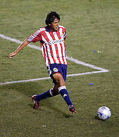 Chivas USA defender and Captain Claudio Saurez (2) passes a ball during the Super Clasico MLS match. The LA Galaxy defeated Chivas USA 5-2 during the SuperClasico at the Home Depot Center Stadium, in Carson, California, Saturday, April 26, 2008.