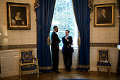 Washington, DC - October 14, 2009 -- United States President Barack Obama talks with Chris Lu, an assistant to the President and cabinet secretary, in the Blue Room of the White House, October 14, 2009. .Mandatory Credit: Pete Souza - White House via CNP