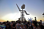 A group hug around &quot;the man&quot; a few moments before the burn.<br /> &quot;Mid Burn&quot; the Israeli &quot;Burning Man Festival&quot; held at &quot;Habonim&quot; beach north of Israel October 4-6, 2012.