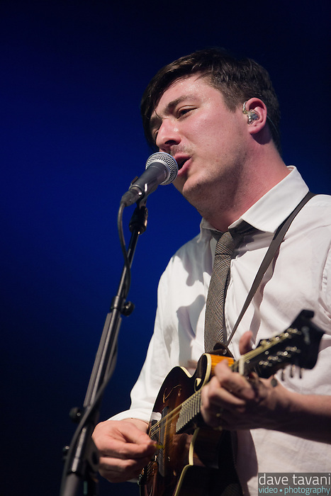 """Marcus Mumford strums the mandolin during a performance of """"Winter Winds"""" at the Susquehanna Bank Center on February 16, 2013."""