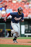 Gwinnett Braves third baseman Edward Salcedo (5) runs to first during a game against the Buffalo Bisons on May 13, 2014 at Coca-Cola Field in Buffalo, New  York.  Gwinnett defeated Buffalo 3-2.  (Mike Janes/Four Seam Images)