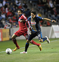 Philadelphia Union midfielder Gabriel Farfan (15) pushes Chicago Fire midfielder Marco Pappa (16) off the ball.  The Chicago Fire defeated the Philadelphia Union 1-0 at Toyota Park in Bridgeview, IL on March 24, 2012.