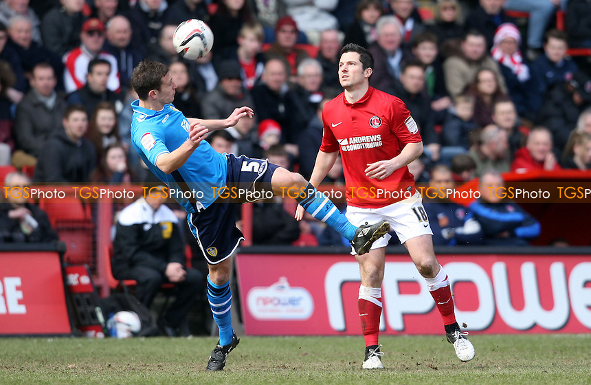 Jason Pearce of Leeds and Yann Kermorgant of Charlton - Charlton Athletic vs Leeds United, nPower Championship at the Valley, Charlton, London - 06/04/13 - MANDATORY CREDIT: Rob Newell/TGSPHOTO - Self billing applies where appropriate - 0845 094 6026 - contact@tgsphoto.co.uk - NO UNPAID USE.