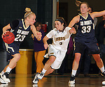 SPEARFISH, SD - DECEMBER 3, 2015 -- Payton Humpal #23 of South Dakota Mines drives toward Black Hills State defender Julia Seamans #3 during their college basketball game Saturday at the Donald E. Young Center in Spearfish, S.D. At right is Megan Rohrer #33 of Mines. (Photo by Dick Carlson/Inertia)