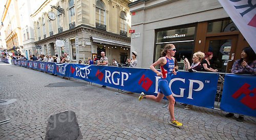 24 AUG 2013 - STOCKHOLM, SWE - Non Stanford (GBR) of Great Britain runs along the cobbled streets during the elite women's ITU 2013 World Triathlon Series round in Gamla Stan, Stockholm, Sweden(PHOTO COPYRIGHT © 2013 NIGEL FARROW, ALL RIGHTS RESERVED)