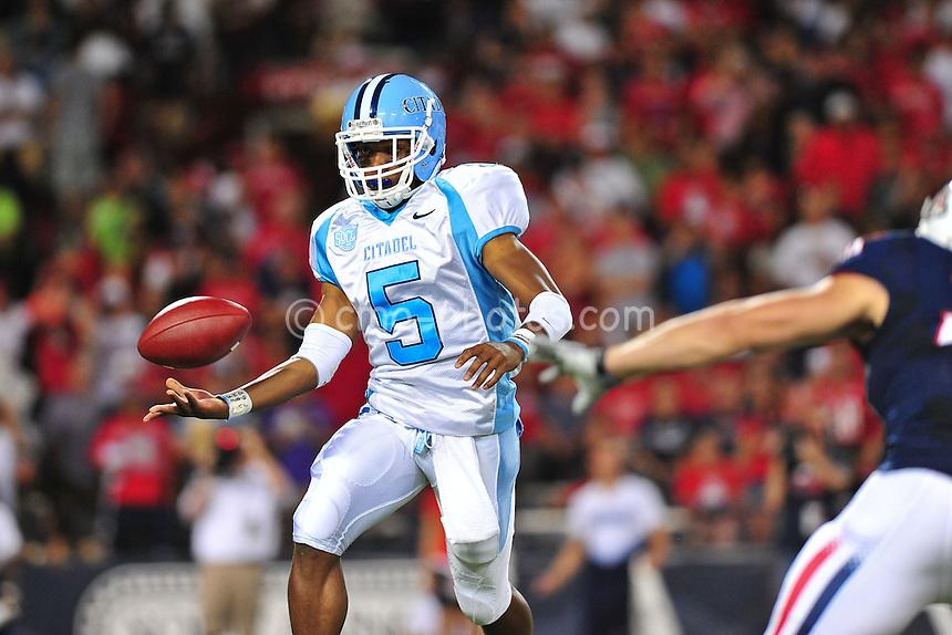 Sept 11, 2010; Tucson, AZ, USA; Citadel Bulldogs quarterback Matthew Thompson (5) pitches the ball on a reverse in the 1st quarter of a game against the Arizona Wildcats at Arizona Stadium.