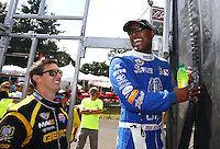 Aug. 4, 2013; Kent, WA, USA: NHRA top fuel dragster driver Antron Brown (right) with Morgan Lucas during the Northwest Nationals at Pacific Raceways. Mandatory Credit: Mark J. Rebilas-USA TODAY Sports