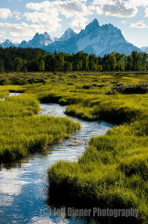 A spring creek flows below the Tetons in Grand Teton National Park, Jackson Hole, Wyoming.