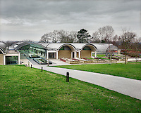 The Wellcome Trust Millennium Building at the Millennium Seed Bank at Wakehurst Place in West Sussex. The building houses facilities for seed-preparation, laboratories and public exhibitions. There is a large storage vault which lies underneath the building. The Millennium Seed Bank Partnership is coordinated by Kew Gardens and aims to collect seeds from every wild plant in the world to insure against extinction. It reached its target of banking seeds from all of the UK's native plant species as well as banking 10% of the world's wild plant species in 2009, and aims to have 25% by 2020..