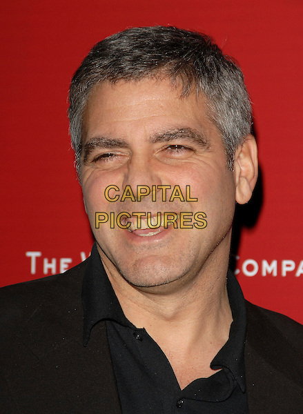 GEORGE CLOONEY .At The Weinstein Company's 2006 Pre Oscar Party held at The Pacific Design Center in Beverly Hills, California, USA, March 4th 2006..portrait headshot funny face screwed up tongue.Ref: DVS.www.capitalpictures.com.sales@capitalpictures.com.©Debbie Van Story/Capital Pictures