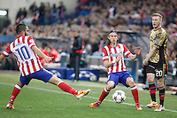 Atletico de Madrid´s Arda Turan (L) and Filipe Luis and Milan´s Ignazio Abate during 16th Champions League soccer match at Vicente Calderon stadium in Madrid, Spain. March 11, 2014. (ALTERPHOTOS/Victor Blanco)