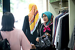 23 JAN, 2018, Jakarta, Indonesia: Shapiro fashion shop sales assistant ,Eka , shows off some clothes to a  customer. The rise of Islamic fashion is bringing massive revenue boosts to the sector and to the Indonesian economy and individual designers and fashion industry as a whole. Pictured in Jakarta by Graham Crouch for Luzerner Zeitung