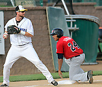 SIOUX FALLS, SD - JUNE 6:  Jared Clark #15 from the Sioux Falls Canaries looks to second as Fehlandt Lentini #24 from Winnipeg is safe at third in the first inning Thursday night at the Sioux Falls Stadium. (Photo by Dave Eggen/Inertia)