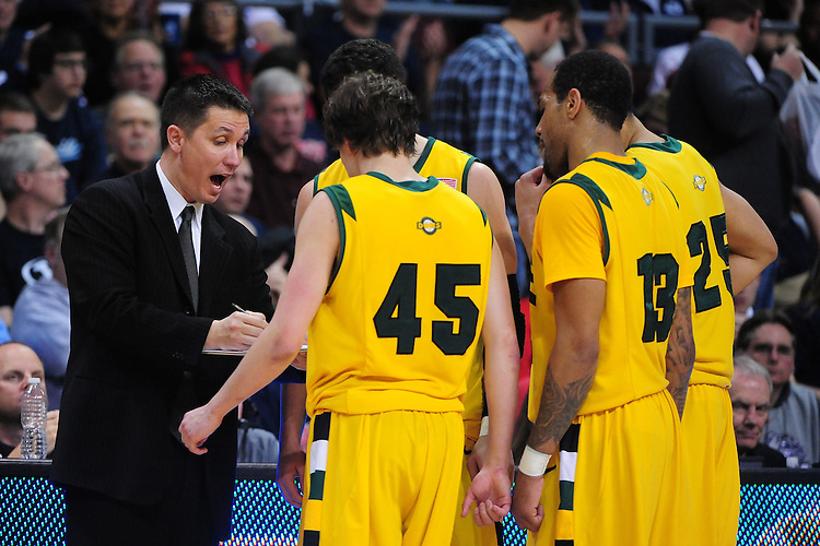 March 3, 2012; Las Vegas, NV, USA; San Francisco Dons head coach Rex Walters (left) instructs his team against the Saint Mary's Gaels during the WCC Basketball Championships at Orleans Arena.