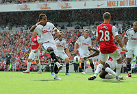 Pictured: Scott Sinclair of Swansea (L) shoots off target. Saturday 10 September 2011<br /> Re: Premiership Arsenal v Swansea City FC at the Emirates Stadium, London.