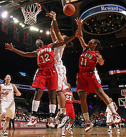 Dec. 6, 2010; Charlottesville, VA, USA; Radford Highlanders guard Breshara Gordon (12) and Radford Highlanders guard Denay Wood (11) reach for a rebound in front of Virginia Cavaliers center Simone Egwu (4) at the John Paul Jones Arena. Virginia won 76-52. Mandatory Credit: Andrew Shurtleff