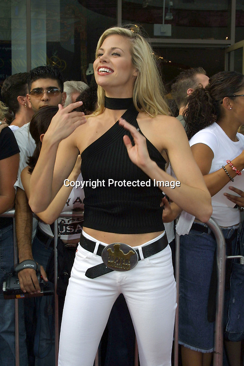"©2002 KATHY HUTCHINS / HUTCHINS PHOTO .AMERICAN IDOL FINALS.AUGUST 4, 2002.KODAK THEATER .HOLLYWOOD, CA..BROOKE BURNS.HOST OF ""DOG EAT DOG"""