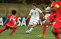 The United States' Jared Jeffrey (8) attempts to maintain control of the ball against South Korea's defence during the FIFA Under 20 World Cup Group C match between the United States and South Korea at the Mubarak Stadium on October 02, 2009 in Suez, Egypt. The US team lost 3-0.