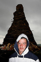 The Irish flag is burned on a giant bonfire made from pallets and old tyres on a Loyalist estate, Belfast Northern Ireland.The bonfires which are seen by the Protestant community as a celebration of loyalist culture in the province are lit on the eve of 12 July, which is the anniversary of the Battle of the Boyne at which the Protestant King William of Orange defeated the Catholic King James in 1690. The festival causes outrage in the nearby republician and Catholic areas of the city.